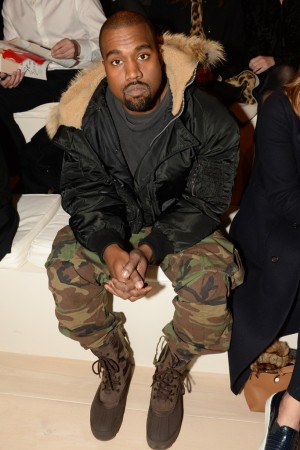 Kanye West sitting front row at Ralph Lauren.