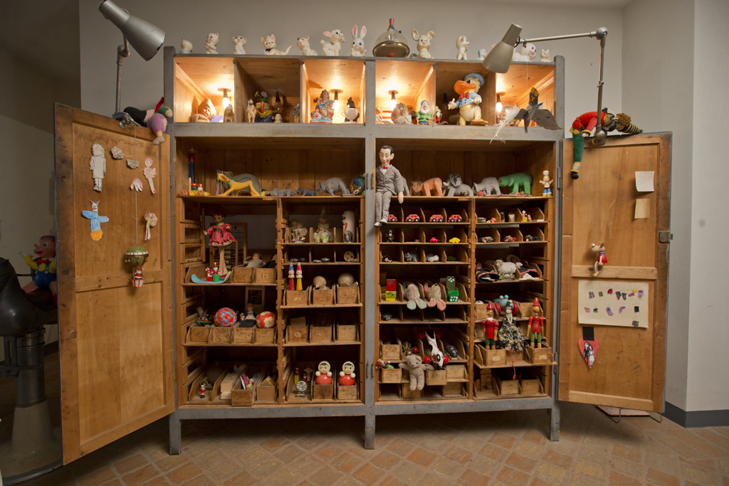 A curio cabinet is full of classic toys at Marras' home in Sardinia.