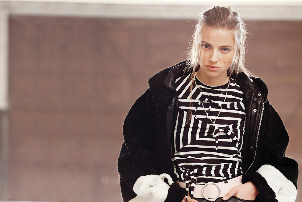 AALTO's sheepskin parka with Cheap Monday's cotton jersey T-shirt and leather pants. Belt by Marimekko; earrings by 1-100.