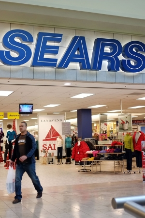 Sears will contribute 10 properties valued at $228 million to the joint venture with Simon Property Group.