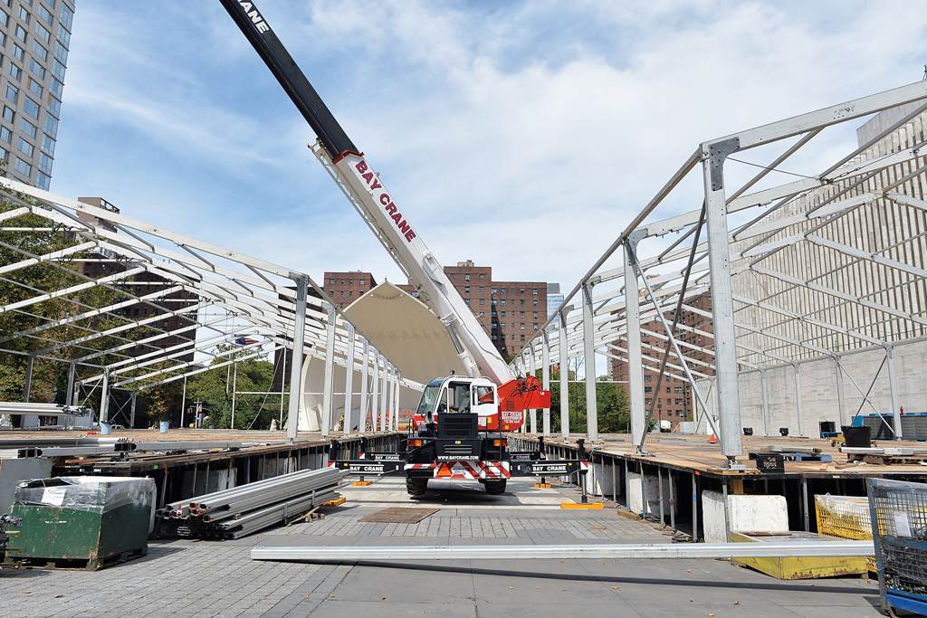 A crane taking down the Lincoln Center tents.
