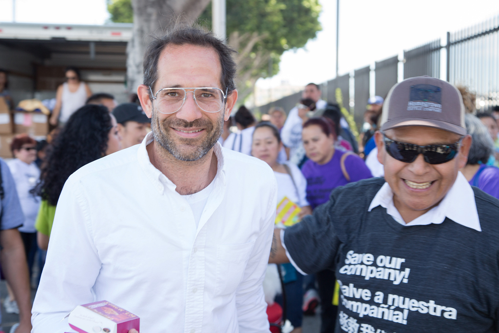 Dov Charney with a supporter outside of the American Apparel headquarters in Los Angeles.