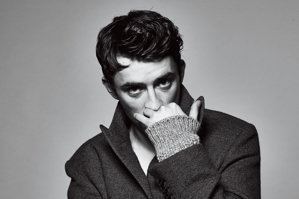 Matthew Beard wearing Joseph's wool coat and Brioni's cashmere sweater.
