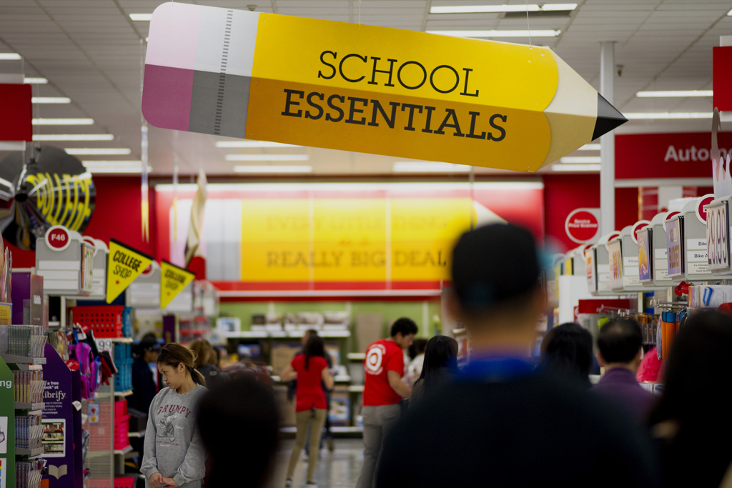 Customers shop for back to school supplies at a Target.
