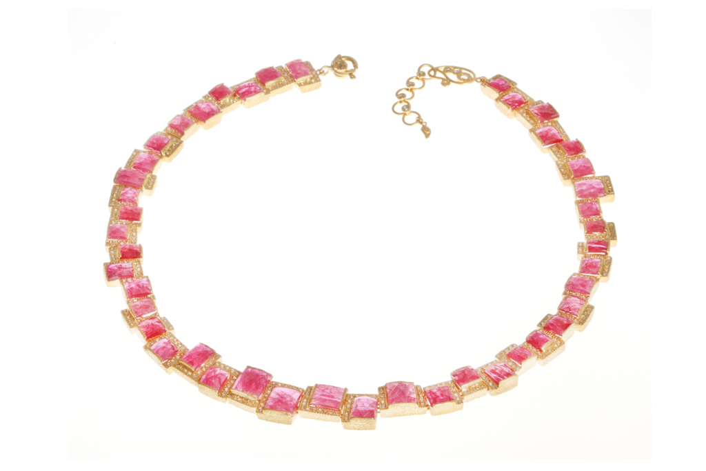 Coomi's 20-karat gold collar with Mozambican rubies.
