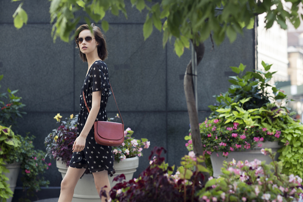 Mansur Gavriel's vegetable-tanned leather saddle bag. Dress by Corey Lynn Calter; sunglasses by Moscot.