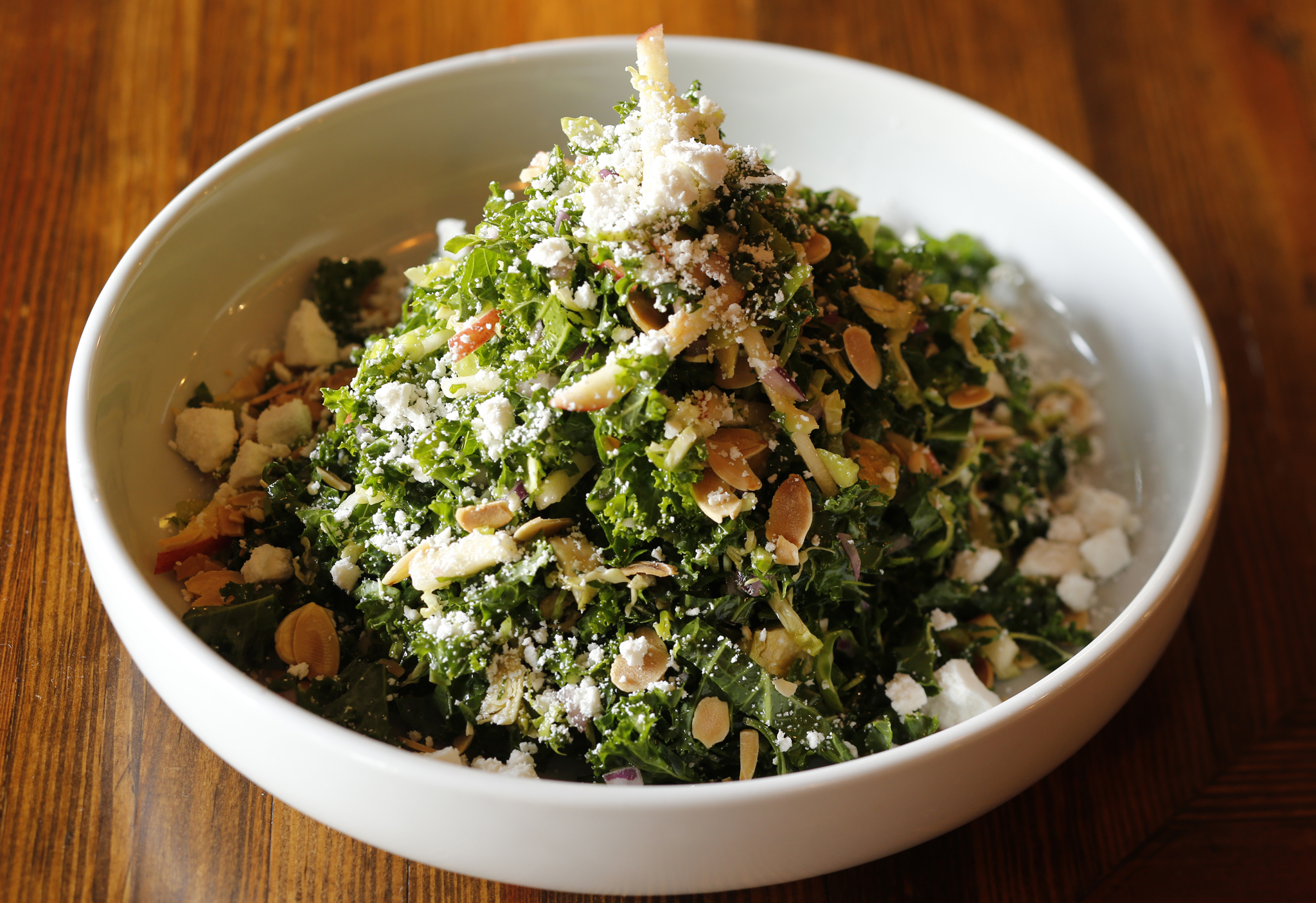 The Pomeroy's kale and brussel sprouts with toasted almonds, ricotta salata, apple, red onion.