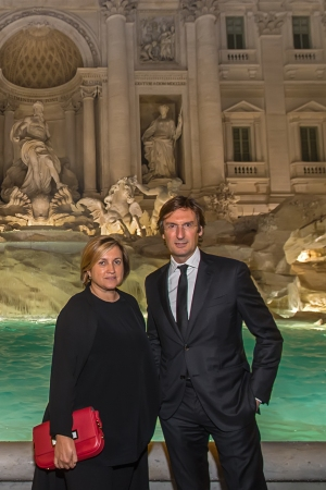 Pietro Beccari and Silvia Venturini Fendi in front of the restored Trevi Fountain.