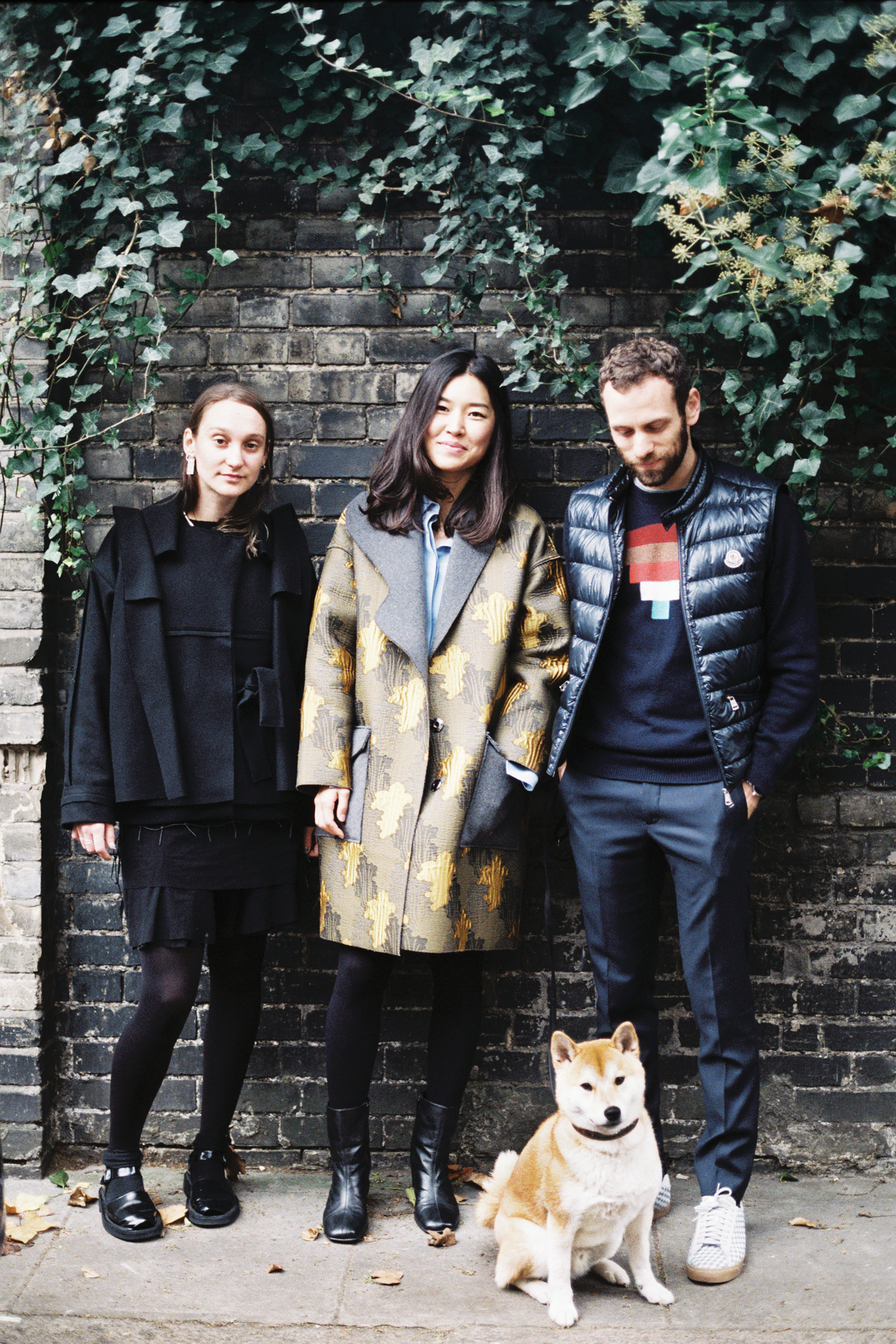 Phoebe English, Rejina Pyo Alexander Lewis and his pooch, Ryo, wearing a Goyard collar.