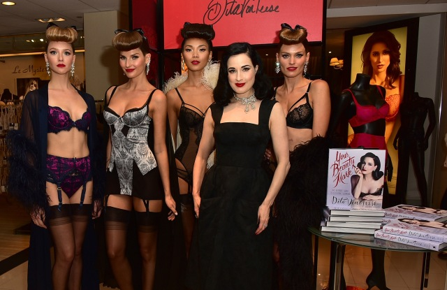 "Dita Von Teese poses with models during her visit to Bloomingdale's 59th Street location to sign copies of her book ""Your Beauty Mark."""