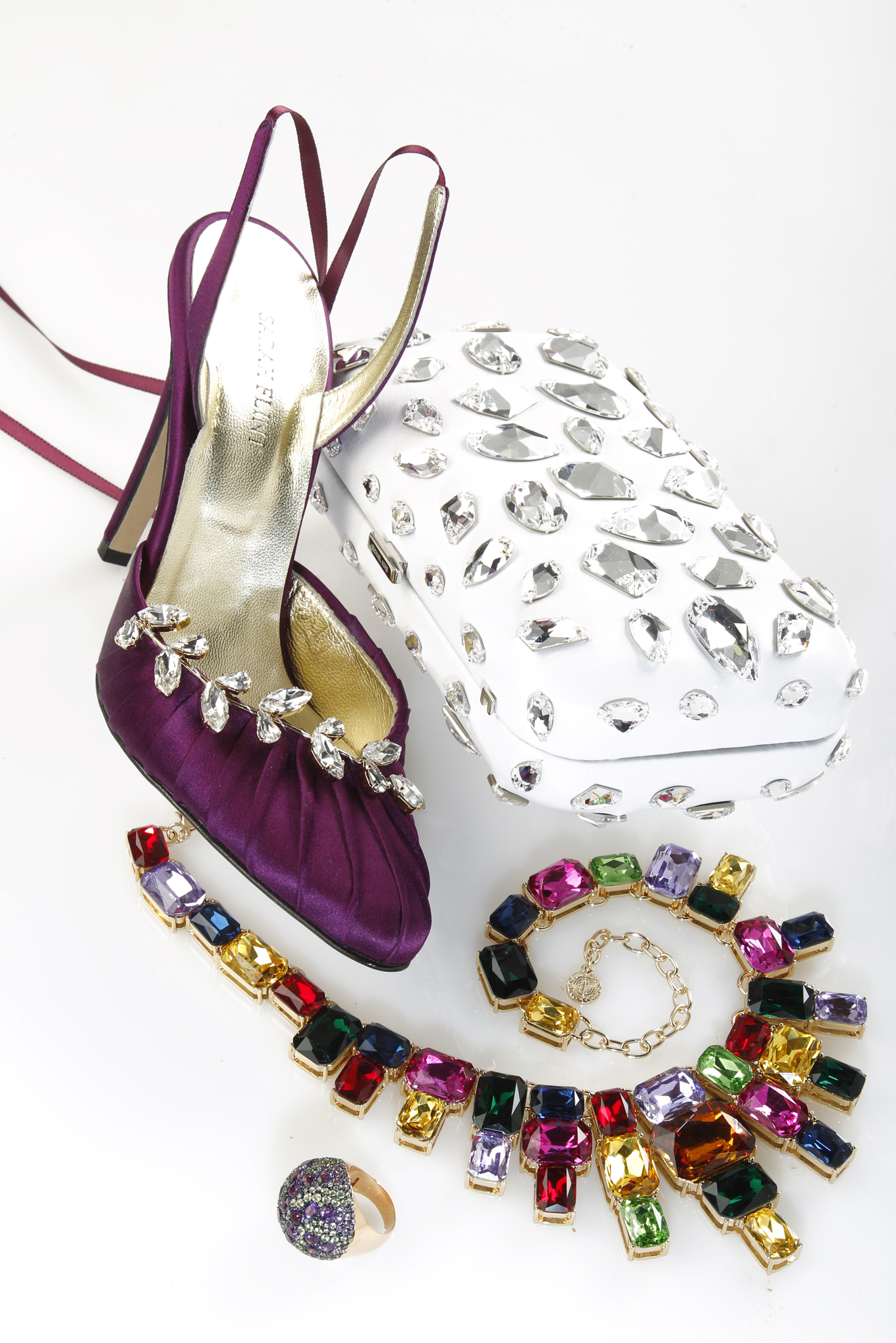 Sarah Flint satin and crystal slingback sandal; Michael Kors leather and crystalclutch; R.J. Graziano glass stone and gold-plated metal necklace; Mattioli 14-karat rose gold, diamond, amethyst and peridot ring.
