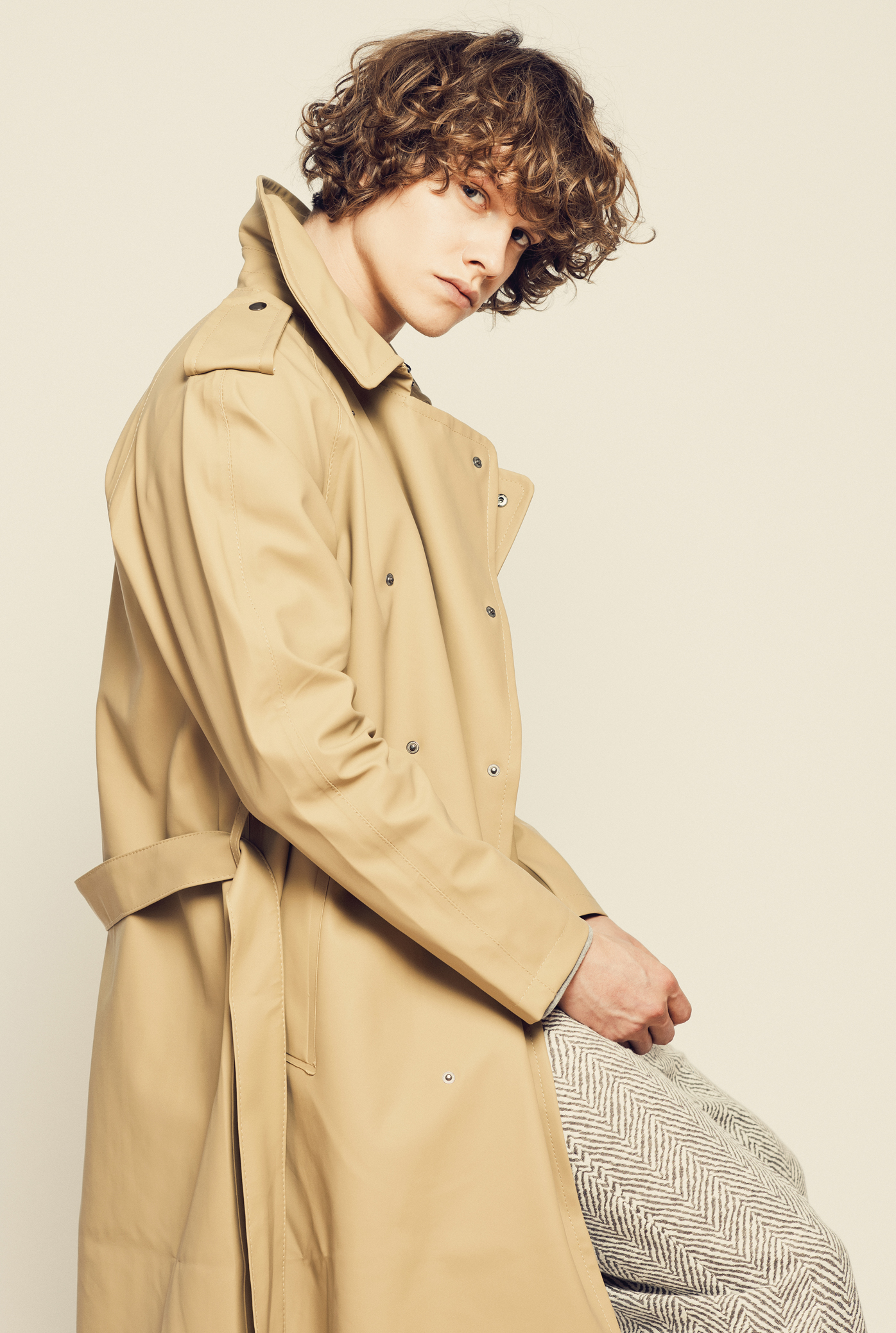 Stutterheim's rubberized trenchcoat and Uniforms for the Dedicated's linen pants.