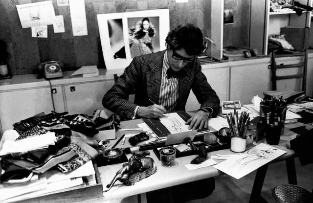 Yves Saint Laurent at his desk in 1976
