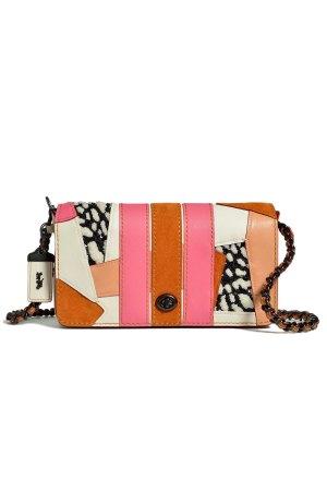 A Coach travel bag.