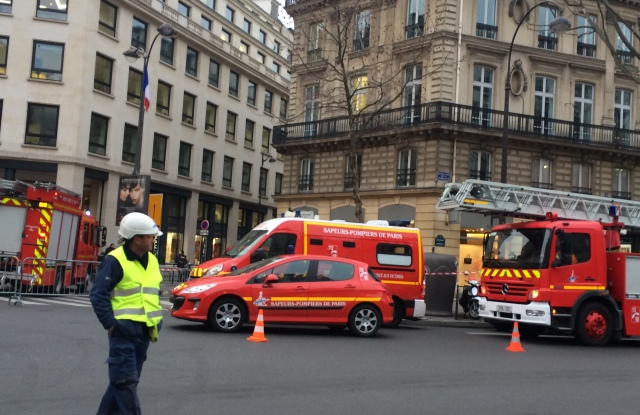 Firefighters blocking the Rue Cambon after a fire broke at the Ritz Paris hotel