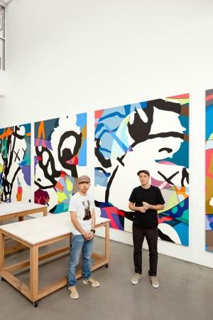 Uniqlo's Nigo with the artist KAWS.