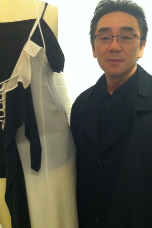 Yuji Yamamoto with one of his father Yohji's designs at La Garconne in Tribeca.