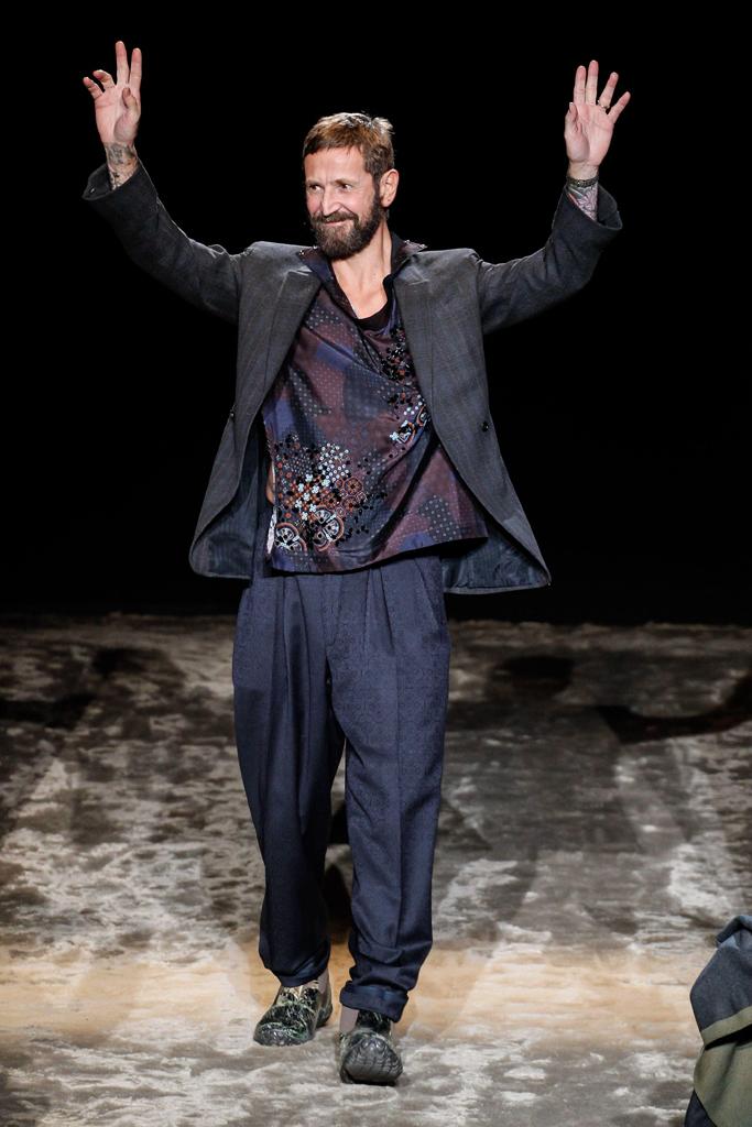 Stefano Pilati takes a bow at his last Ermenegildo Zegna show in Milan