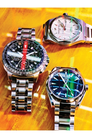 Stainless-steel watches from Girard-Perregaux, Citizen and Omega.