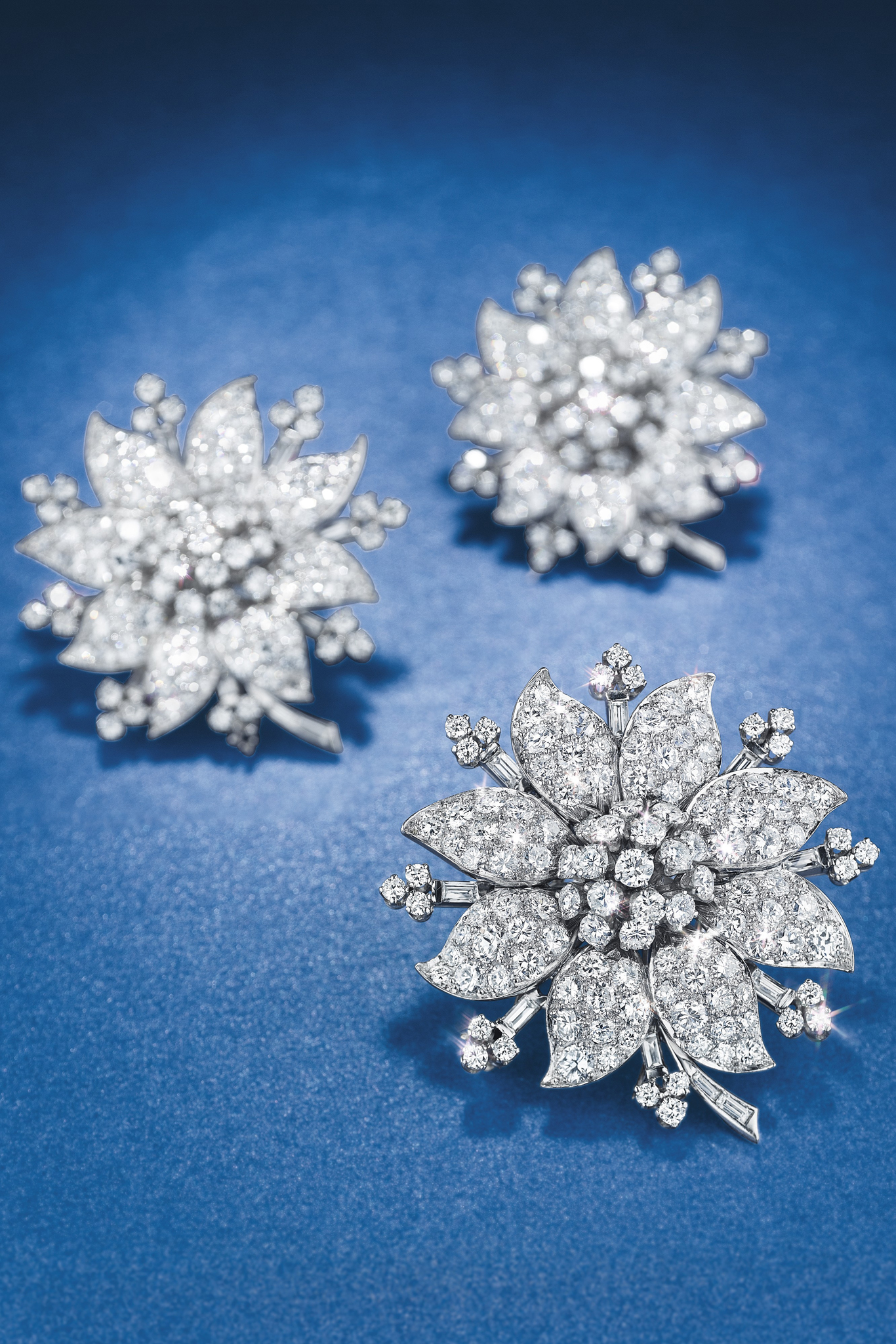 A diamond flower necklace with three detachable brooches by Van Cleef & Arpels