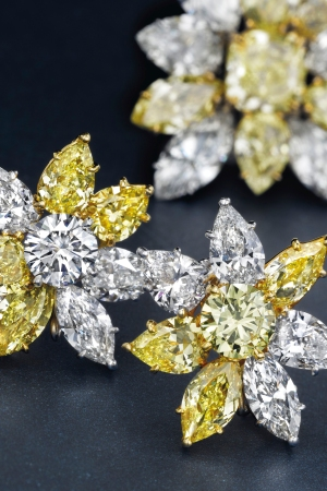 A pair of colored diamond and diamond ear clips by Cartier.