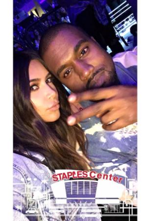 Kim Kardashian and Kanye West at Justin Bieber's Purpose tour.