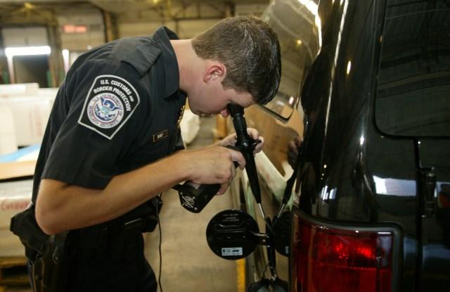 A CBP officer inspects a shipment.