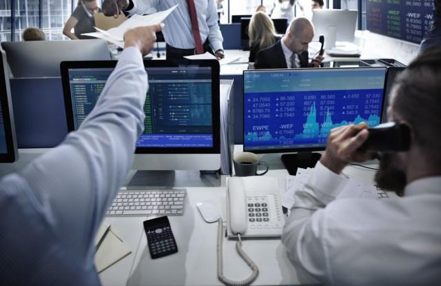 Stock market traders.
