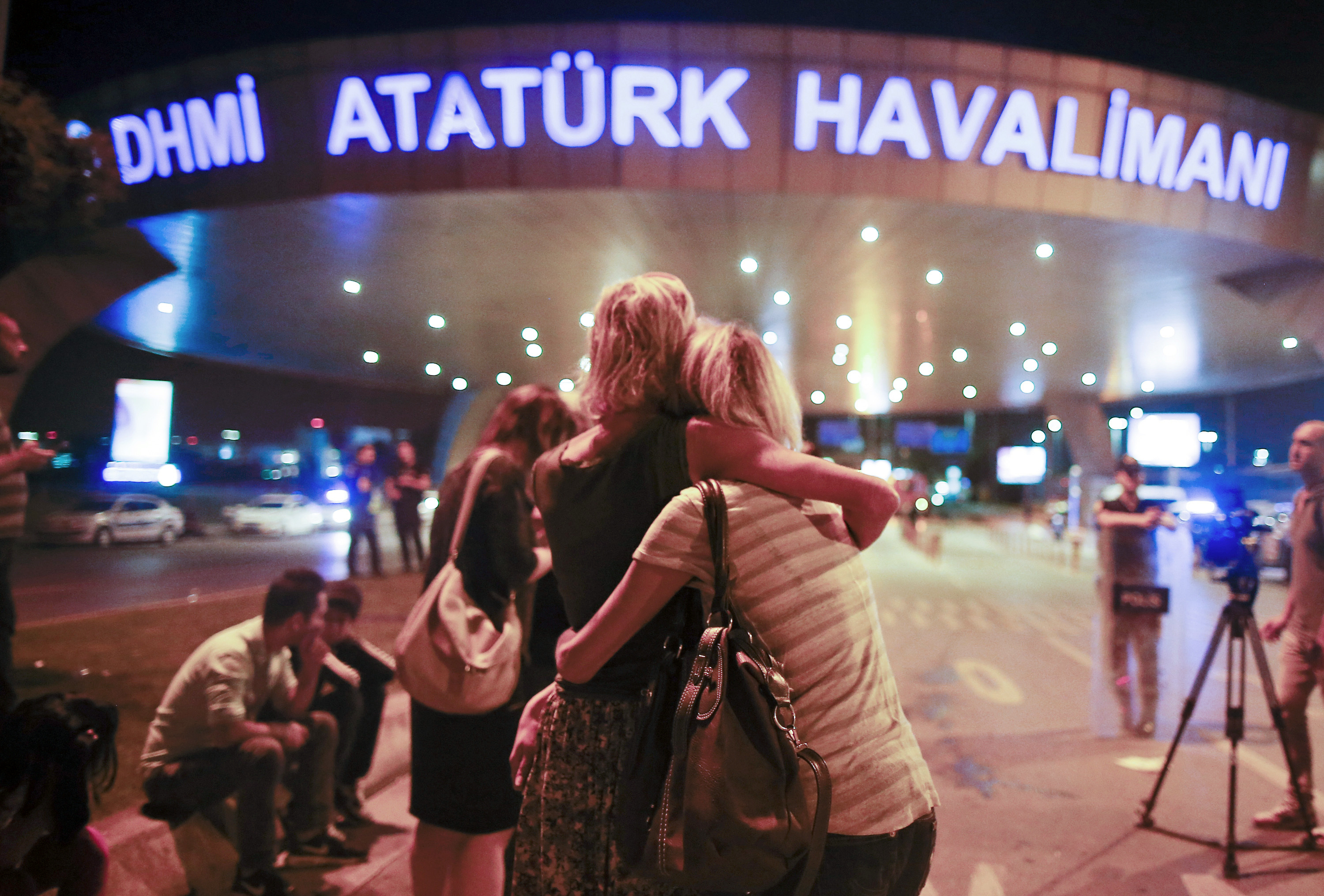 Passengers outside the entrance to Istanbul's Ataturk airport following their evacuation after the attack.