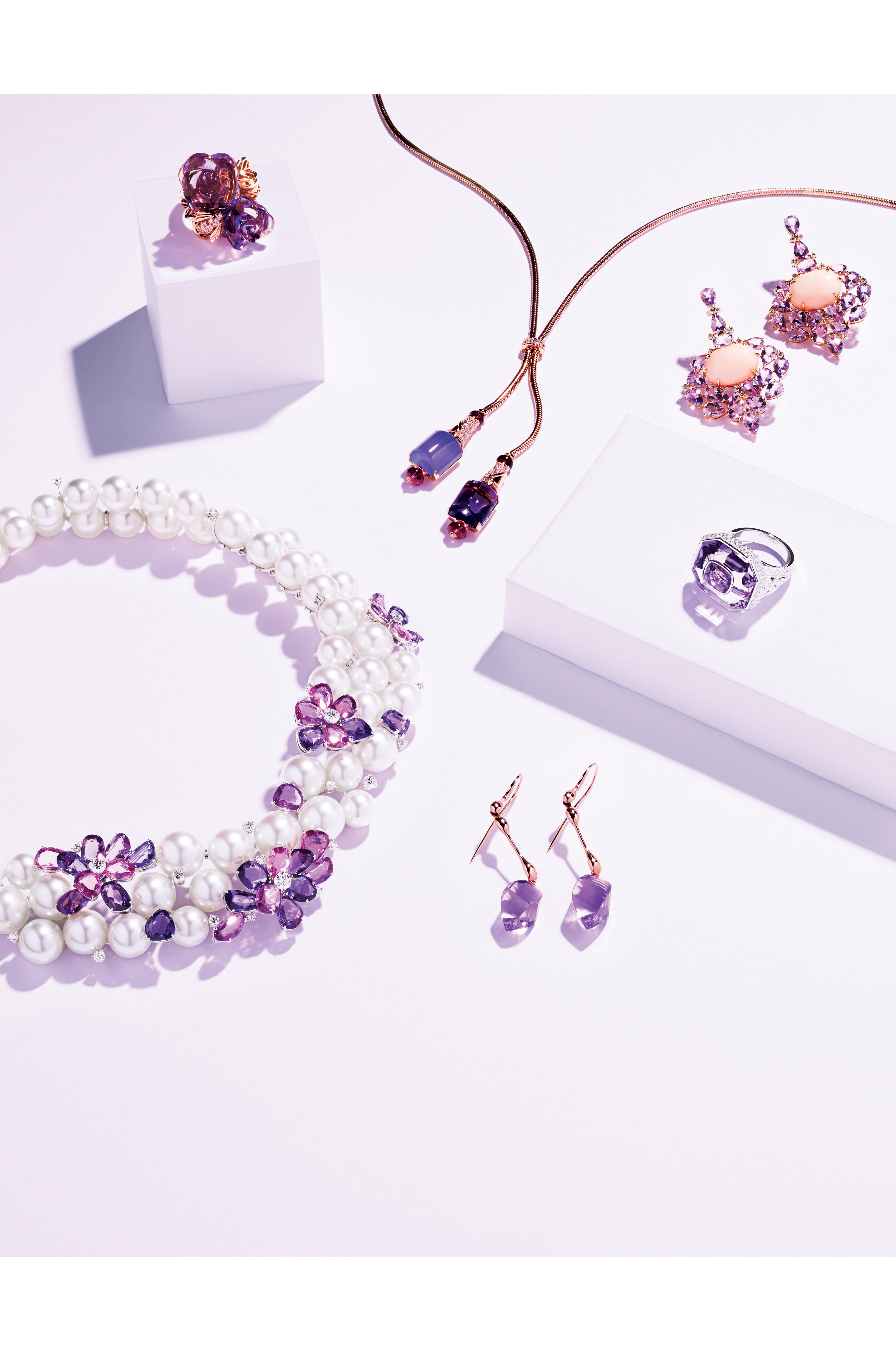 Clockwise from top left: Dior Fine Jewelry's 18-karat rose gold ring with amethysts and diamonds; Bulgari's 18-karat pink gold necklace with amethyst, chalcedony, rubellite and diamonds; Sutra's 18-karat rose gold earrings with angel skin coral and rose de France amethysts; Cartier's platinum ring with sapphires, amethysts and diamonds;  Lucifer Vir Honestus' 18-karat rose gold and amethyst earrings; Mikimoto's 18-karat white gold necklace with cultured pearls, sapphires and diamonds.