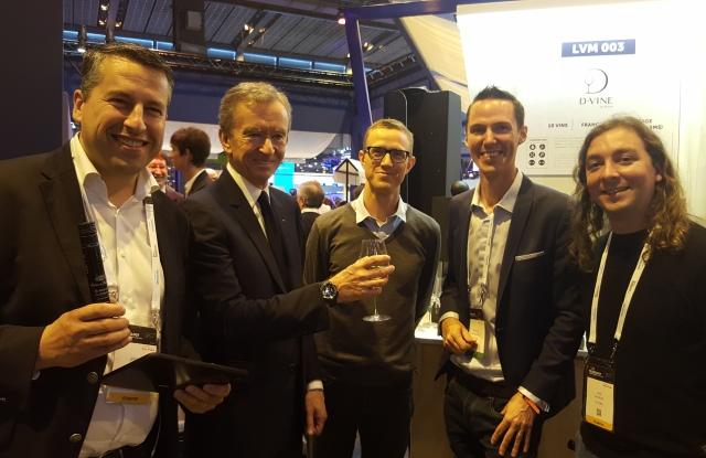 Bernard Arnault and Ian Rogers touring startups at the Viva Technology conference
