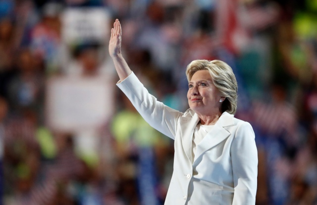 Democratic presidential nominee Hillary Clinton waves after taking the stage during the final day of the Democratic National Convention in Philadelphia.