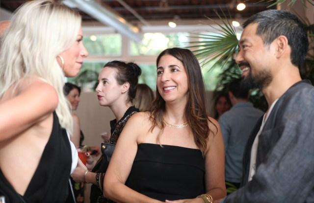 Andrea Lieberman (center).
