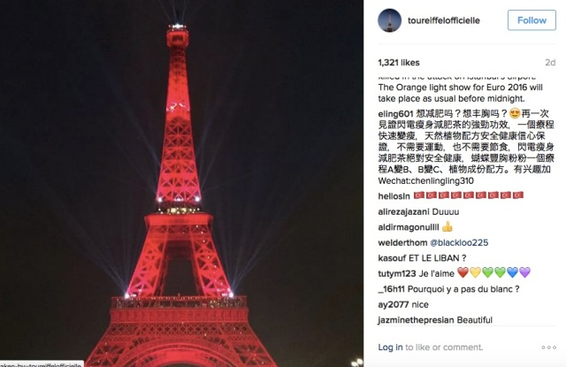 The Eiffel Tower lit up in red to honor people killed in Istanbul's airport attacks