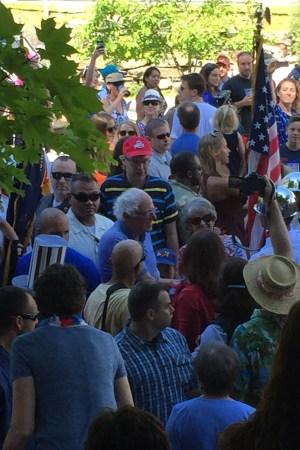 Bernie Sanders greets fans on the Fourth of July in Warren, Vt.