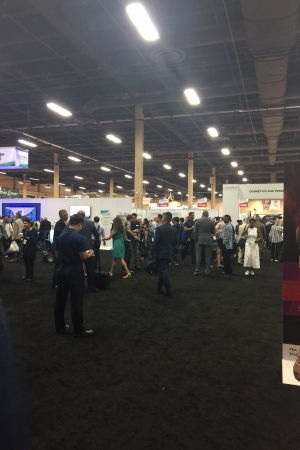 Cosmoprof North America attendees flock to the opening of the show floor.