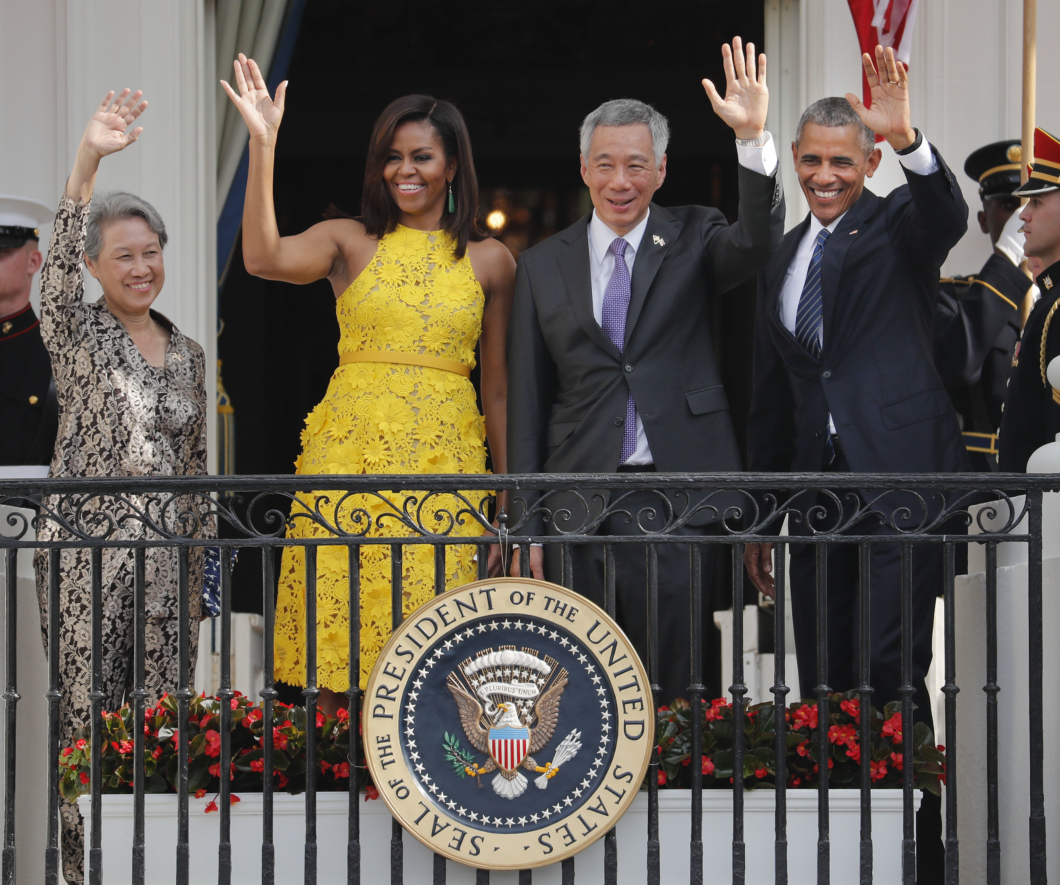 President Obama, First Lady Michelle Obama, Singapore's Prime Minister Lee Hsien Loong and his wife Ho Ching wave from the Truman Balcony of the White House.