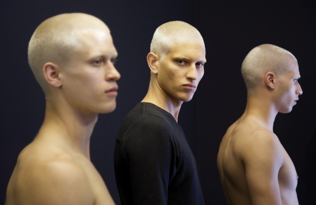 Model John Kolic backstage at Givenchy, for which his hair was bleached at L'Atelier Blanc.