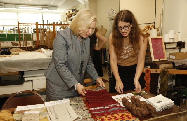 Sen. Kirsten Gillibrand speaks with designer, Nica Annette Rabinowitz during her tour of the Manufacture New York facility in Brooklyn.