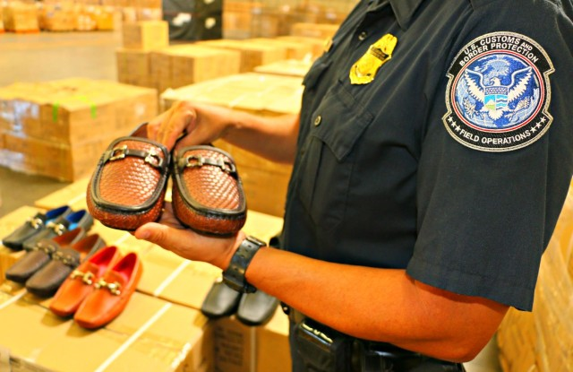 thumbnail_CBP Officer Showing Ferragamo Seized Shoes