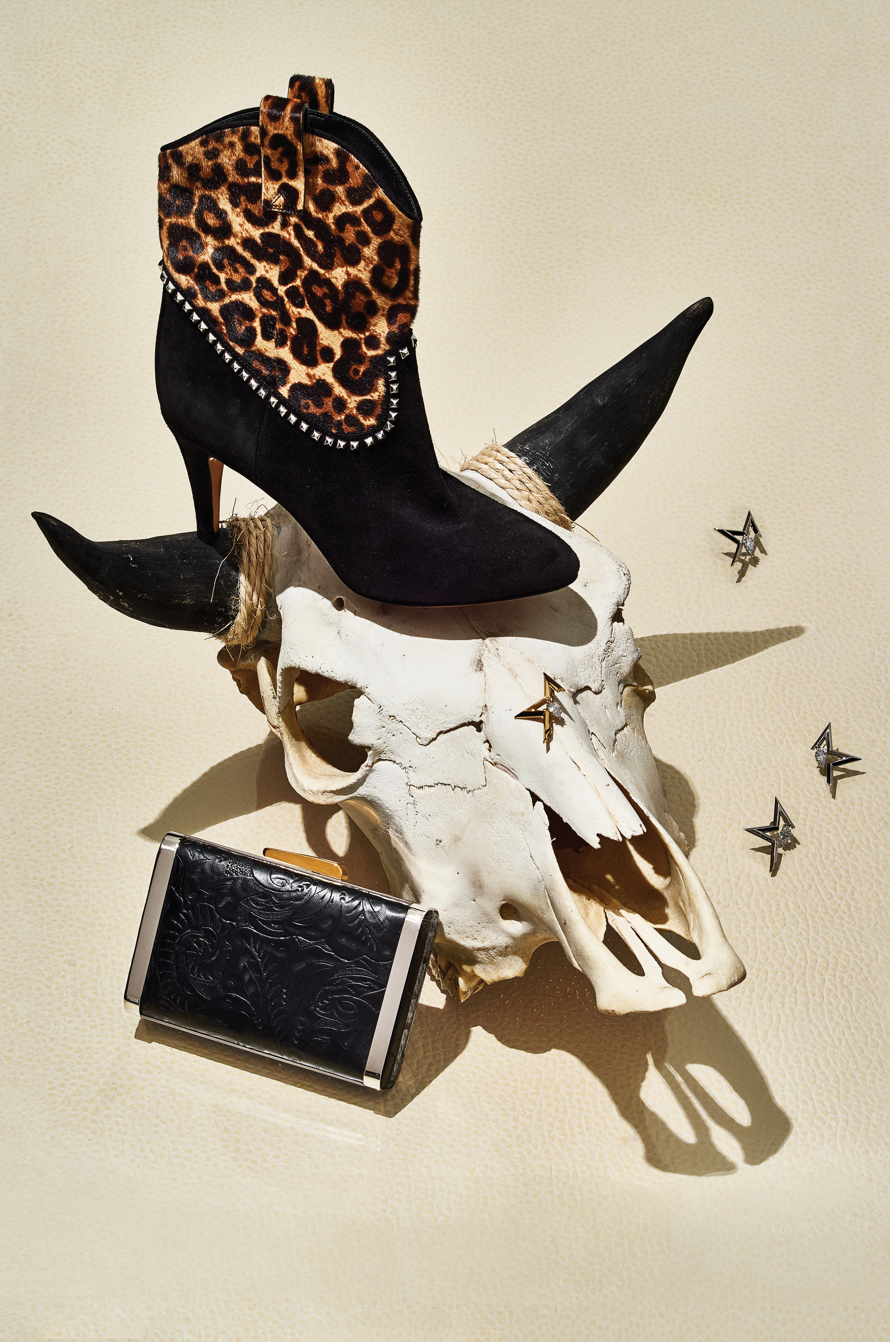 Marc Jacobs' calf hair and leather boot; Eddie Borgo's plated silver and gold earrings and brooch with hand-cut crystals; Hayward's leather and gray skakeskin clutch.