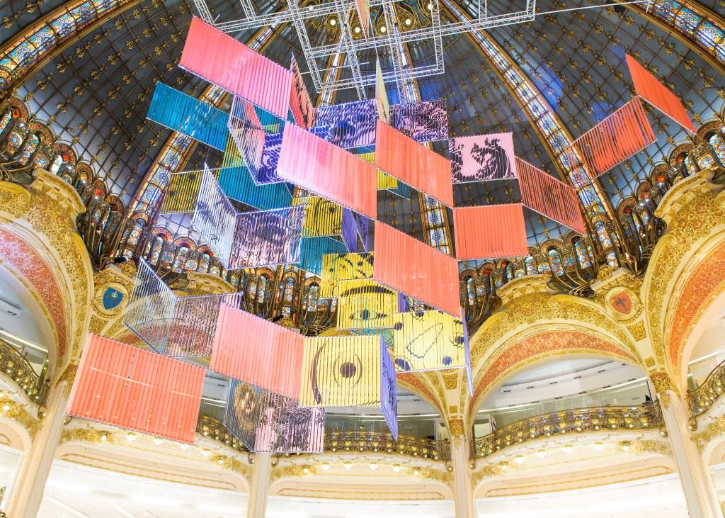 Haegue Yang's installation in the atrium of the Galeries Lafayette flagship in Paris