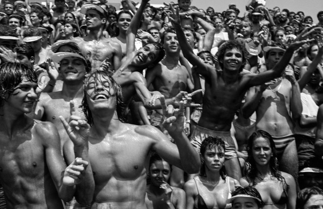 """Sweaty bodies of another kind: Bruce Weber's crowd at a beach volleyball match in Rio de Janeiro, 1986, part of """"Far From Home."""""""