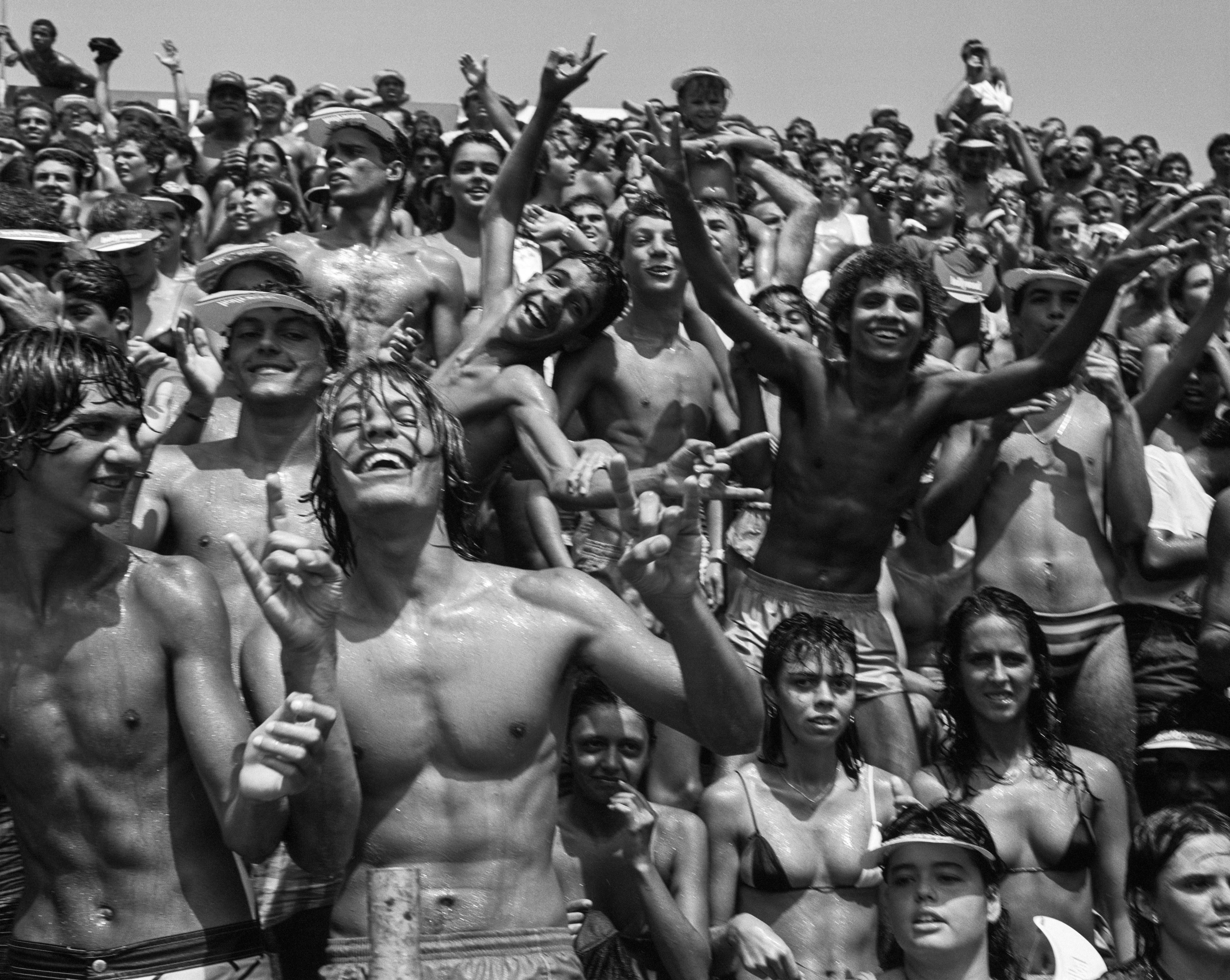"Sweaty bodies of another kind: Bruce Weber's crowd at a beach volleyball match in Rio de Janeiro, 1986, part of ""Far From Home."""