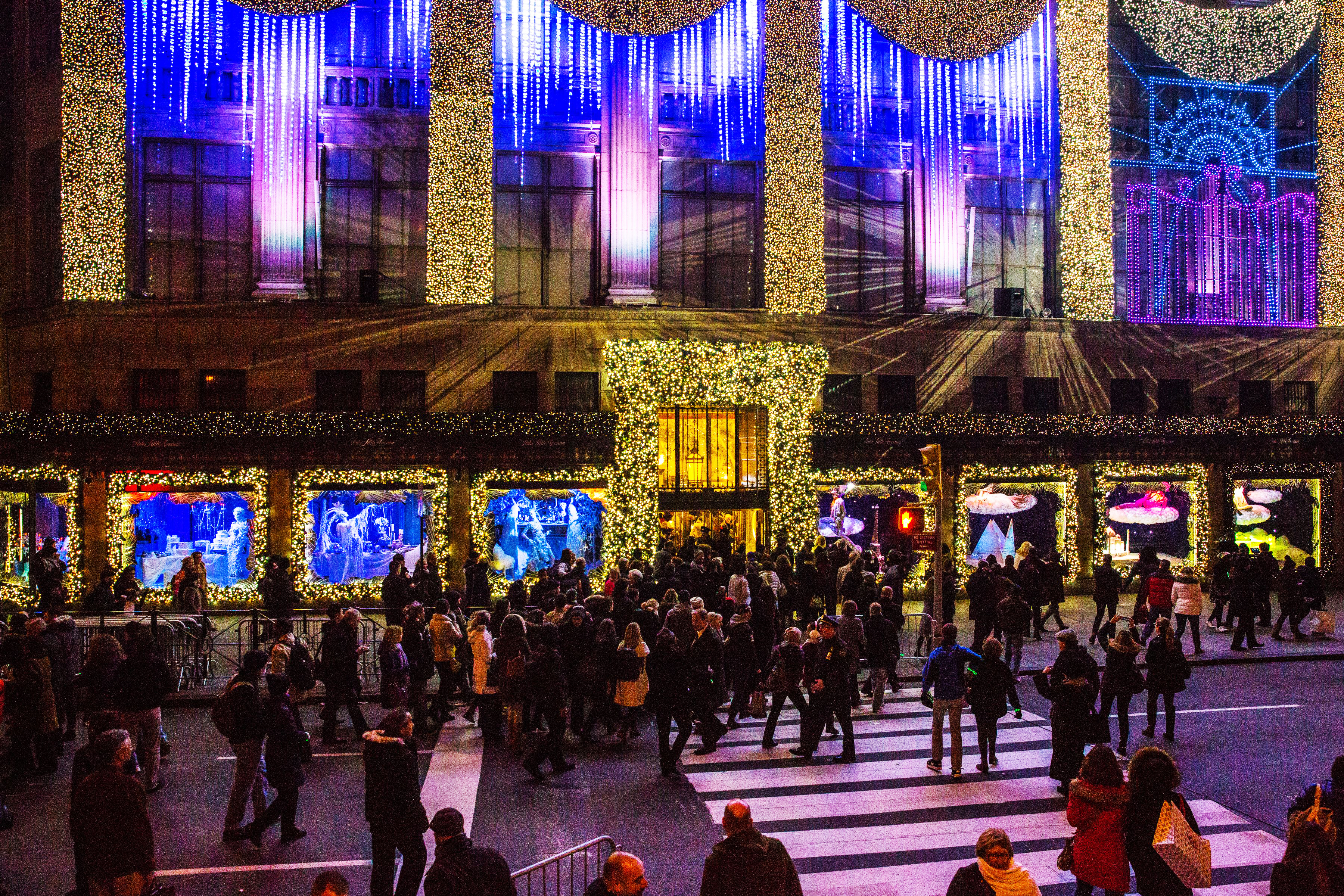 Holiday shopping outside Saks Fifth Avenue, NYC.