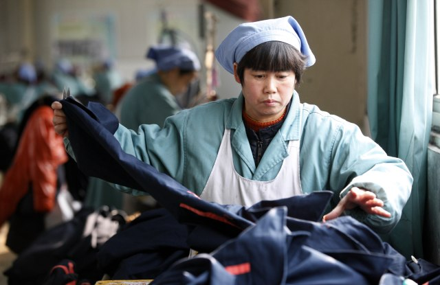 Women working at a clothes factory in Huaibei city, Anhui province, China - 19 Jan 2016