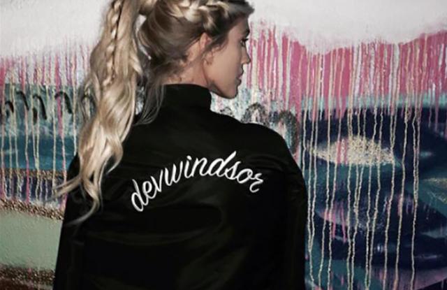 Model Devon Windsor in her Cinq à Sept x Shopbop bomber jacket.