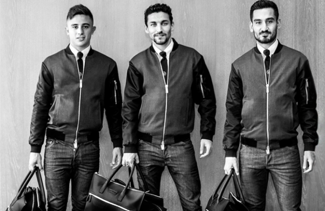 Manchester City's players (from left) Pablo Maffeo, Jesús Navas  and İlkay Gündoğan dressed in Dsquared2 casual attire.