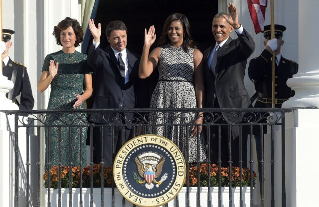 President Barack Obama, first lady Michelle Obama, Italian Prime Minister Matteo Renzi and his wife Agnese Landini, wave from the Truman Balcony of the White House in Washington.