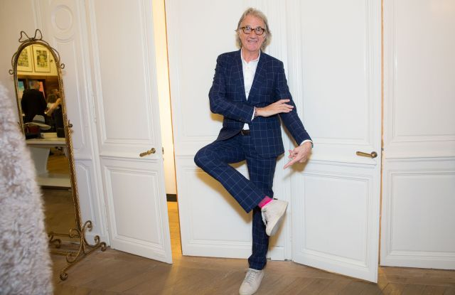 Paul Smith showing off John Tierney collaboration socks